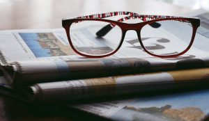 Glasses on papers ready for job hunt before your move