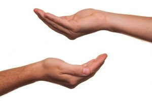 Two open hands offering.