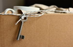 a cardboard box filled with things with a key sticking out of it.