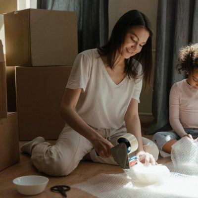 Woman with daughter packing