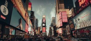 Tourists on Time Square as one of the reasons for moving your Bed&Breakfast from LA to NYC.
