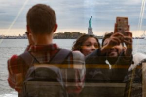 people taking photo in NYC and showing that New York is so attractive to Philadelphians