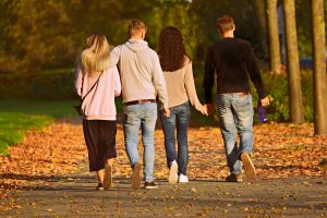 Two couples walking.