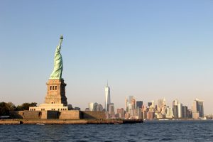 View of NYC with the Statue of Liberty up front