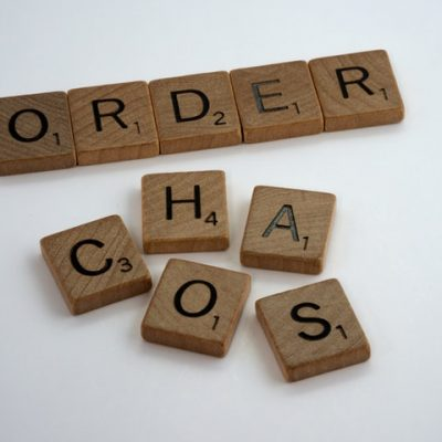 There are some wooden blocks making words 'order' and 'chaos'.