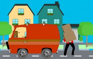 Loading items into a moving van.