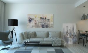 White sofa with pillows on it and a painting above. Living room. Spacy.