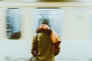 a man waiting for subway train to Queens