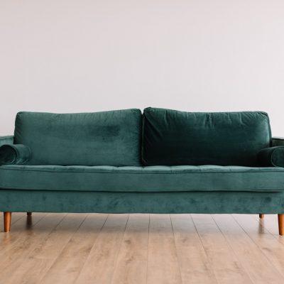 green fabric sofa ready for downsizing